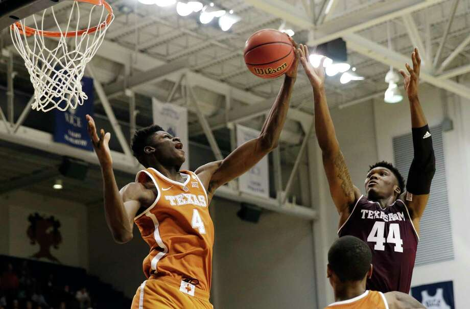FILE - In this Wednesday, Oct. 25, 2017, file photo, Texas forward Mohamed Bamba (4) grabs a rebound from Texas A&M forward Robert Williams (44) in the second half of a college basketball charity game in Houston, to benefit the Rebuild Texas Relief Fund. The Longhorns were embarrassed by a last-place finish in the Big 12 last season. But coach Shaka Smart thinks he can turn it around behind top recruits Mo Bamba and Matt Coleman. (Tim Warner/Houston Chronicle via AP, File) Photo: Tim Warner, AP / Houston Chronicle