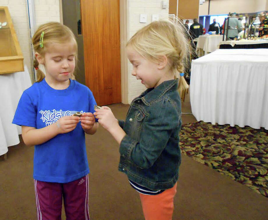 Two Midland girls attend their first MidMichigan Rock Club rock show in 2014. The club's annual rock show is Nov. 4-5 at the Chippewa Nature Center. Admission is free. Photo: Daily News File Photo