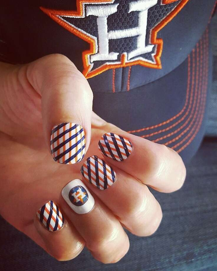 Houstonian Michelle Pauli displays a unique Astros-colored nail pattern accented with the classic team logo. Photo: Michelle Pauli