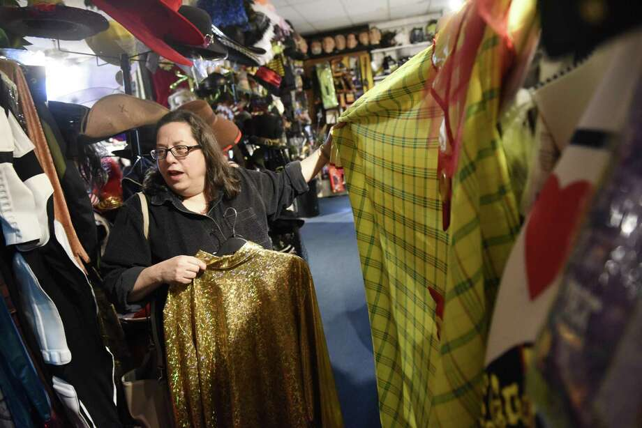Westport's Suzy Brag looks at costumes at Sophia's costume store in Greenwich, Conn. Wednesday, Oct. 18, 2017. As Halloween approaches, Sophia's is one of the go-to places in Greenwich to rent or buy costumes and accessories. Photo: Tyler Sizemore / Hearst Connecticut Media / Greenwich Time