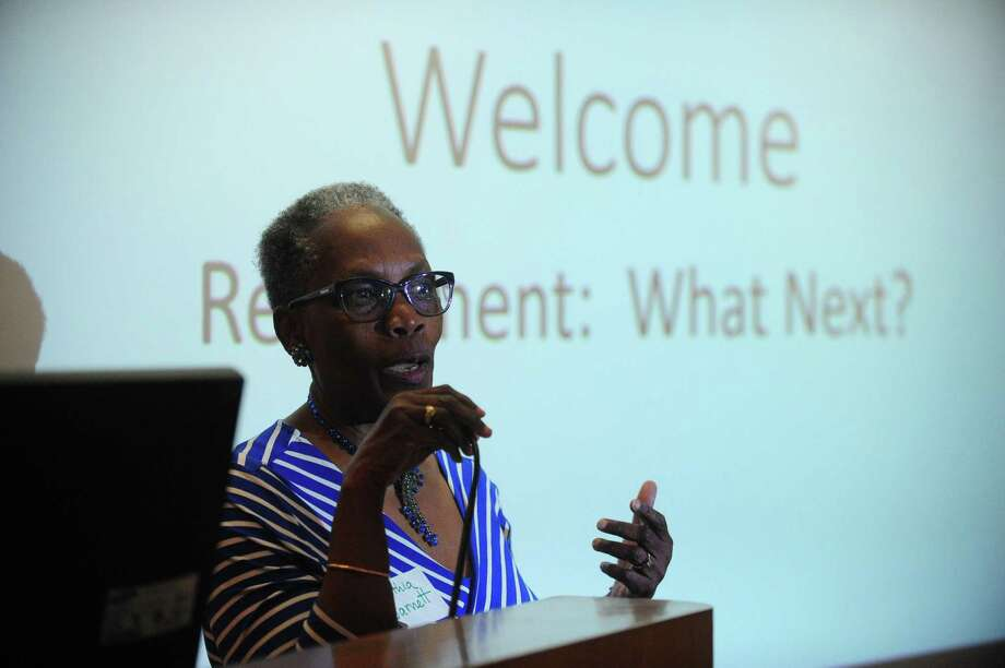 Former teacher Dr. Cynthia Barnett welcomes attendees during Life Beyond the Classroom, a program dedicated to sharing the stories of teachers who have found success in their post-retirement lives helping those who may be nearing retirement, Thursday, May 4, 2017, at Norwalk Community College. For many teachers, their professions becomes far more than just a way to make money; it becomes part of their identity. So when it comes time for them to retire, while many have their financial needs plans, they end up at a loss emotionally and psychologically as they seem to have lost a part of who they are. Photo: Erik Trautmann / Hearst Connecticut Media / Norwalk Hour