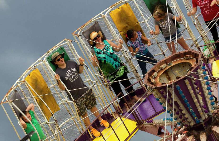 Patrons enjoy a carnival ride during the annual Fire and Ice Festival at Texan Drive Stadium, Saturday, Oct. 21, 2017, in New Caney. Photo: Jason Fochtman, Staff Photographer / © 2017 Houston Chronicle