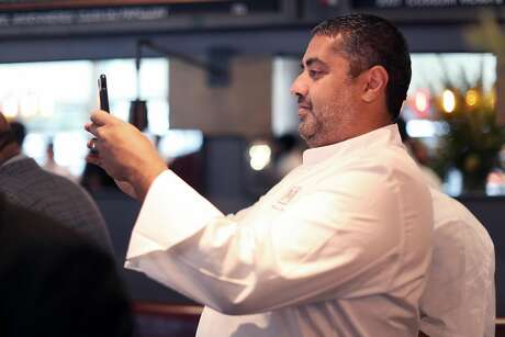 Michael Mina, photographing a fellow chef, is opening Trailblazer Tavern at the Salesforce East Building, slated to open in November. Photo: Scott Strazzante / The Chronicle 2017