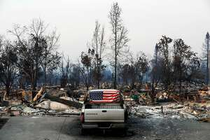 An American flag was placed inside the broken out back window of a burned out vehicle in the Coffey Park neighborhood, a week after the start of the massive fires in Santa Rosa, Ca. as seen on Monday October 16, 2017.