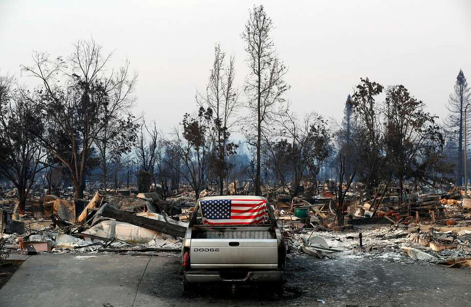 An American flag was placed inside the broken out back window of a burned out vehicle in the Coffey Park neighborhood, a week after the start of the massive fires in Santa Rosa, Ca. as seen on Monday October 16, 2017. Photo: Michael Macor, The Chronicle