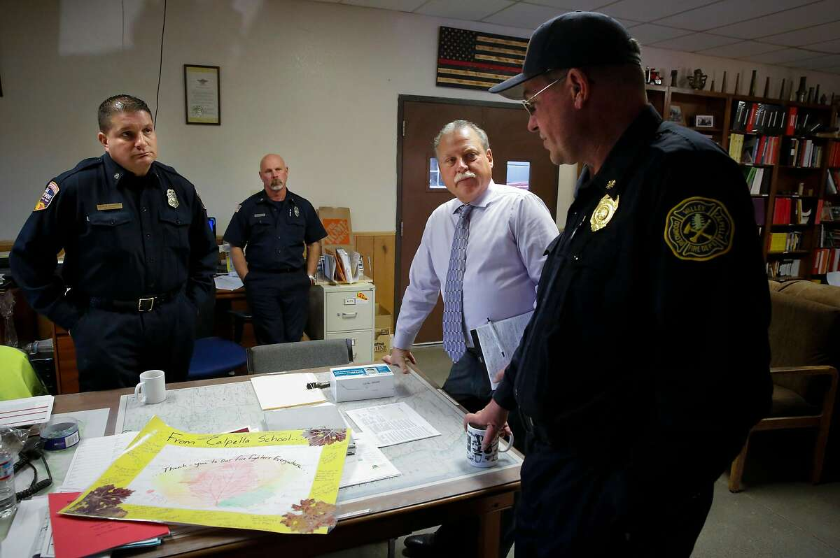 ( l to r ) CalFire's Mendocino Unit Chief George Gonzalez, Kerry Robinson, Redwood Valley Calpella Fire Department fire captain, Mendocino County Sheriff Thomas Allman and acting chief Brendan Turner, of the Redwood Valley Calpella Fire Department talks things over at headquarters in Redwood Valley, Ca. on Wednesday October 25, 2017. The Redwood Valley fire burned 36,523 acres, destroyed 545 structures and left eight people dead.
