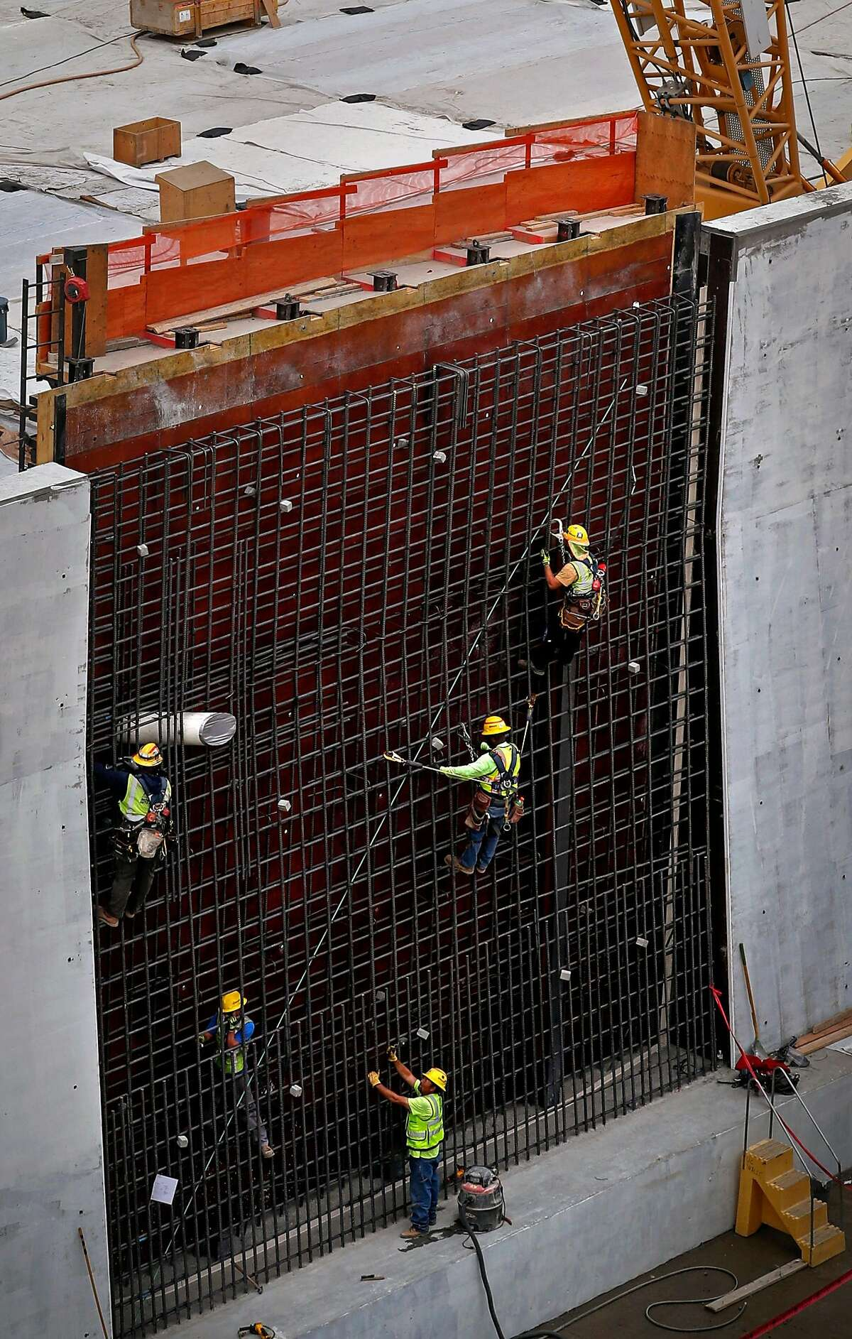 Workers set the rebar in the concrete forms to build the walls of the main spillway as construction and repairs continue on the Oroville Dam, in Oroville, Ca., on Thursday October 19, 2017.