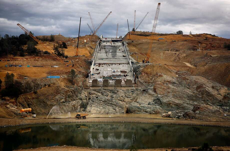 Repairs are made on the main spillway of the Oroville Dam in October. The dam, in the Sierra Nevada foothills, is the nation's tallest. The main and emergency spillways sustained damage during winter storms. Photo: Michael Macor, The Chronicle