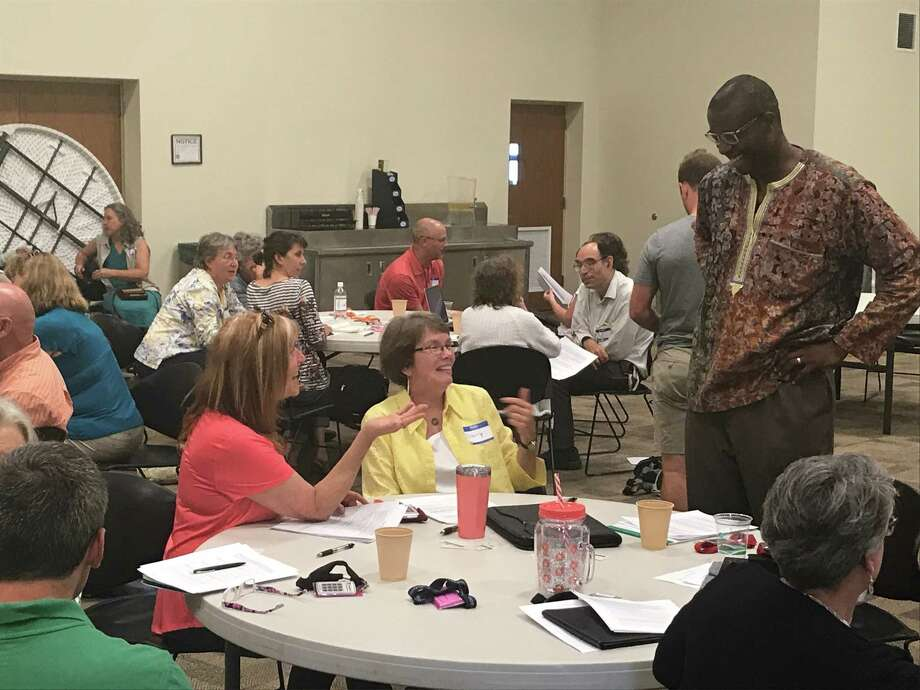 David Campt teaches workshops for whites who want to persuade racist or biased loved ones to change their bigoted views. Here, he chats with students in a Harrisonburg, Virginia workshop. He will be teaching in Albany this Sunday. Photo: Lynda J. Edwards, Submitted