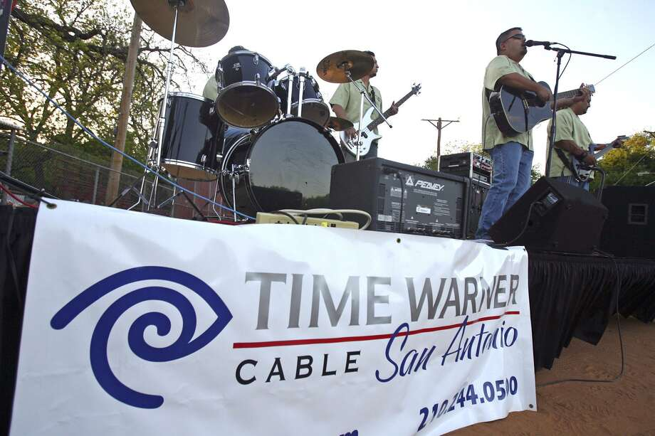 "The city of San Antonio is suing Time Warner Cable Texas for allegedly unpaid franchise fees totaling more than $6 million. In this 2008 photo, Time Warner Cable employees perform before showtime at the Time Warner Cable ""Movie in the Park"" at Brackenridge Park. Photo: Express-News File Photo / SAN ANTONIO EXPRESS-NEWS"