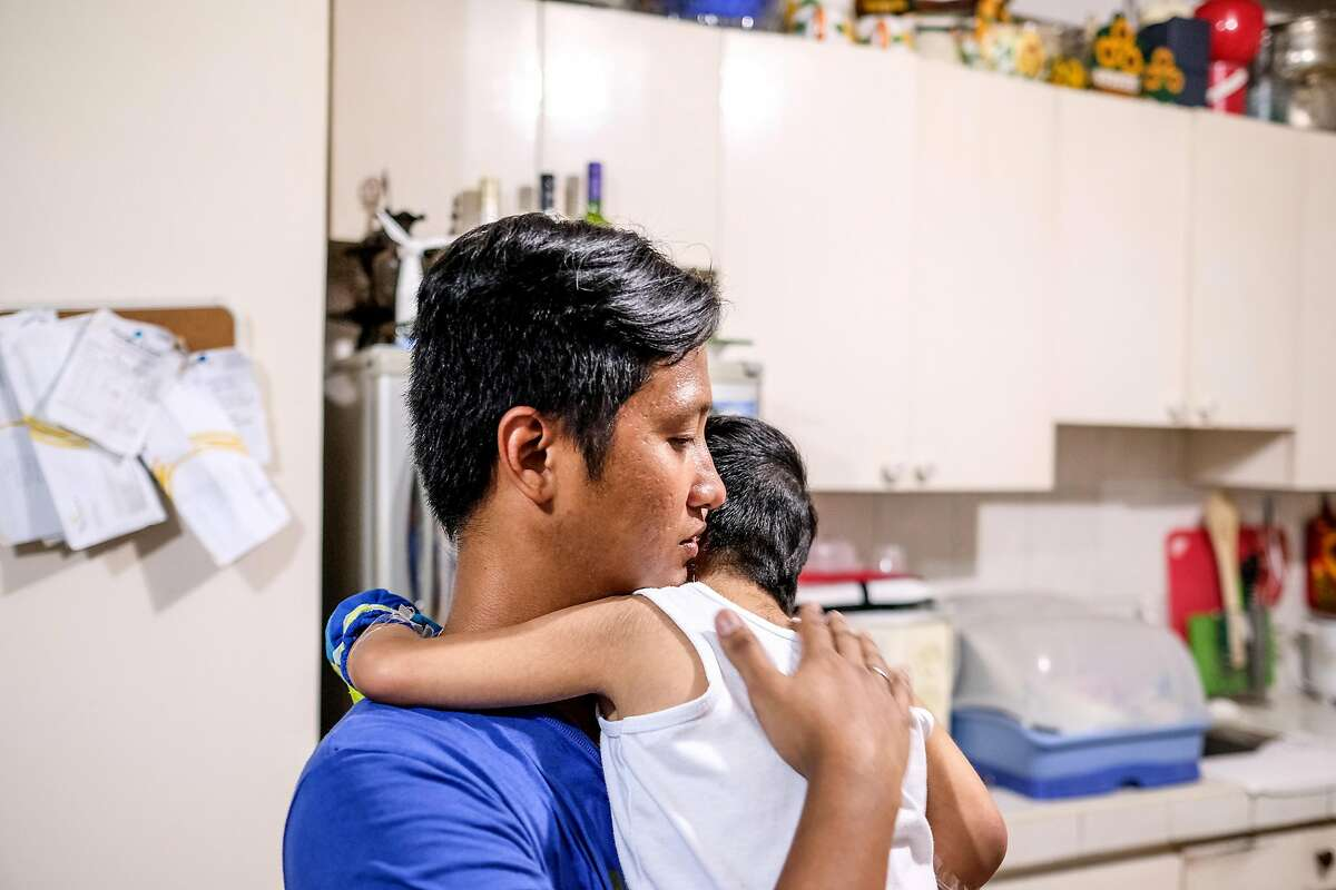 Rolando Cuartero tends to to his son�s needs from his house in Novaliches, Quezon City last July 1, 2017. Rolando and his wife are just one of several individuals who shifted from the traditional corporate office setup to home based Business Process Outsourcing (BPO) Industry as he said it is more favorable for them financially and also for the family as their son needs special medical attention.