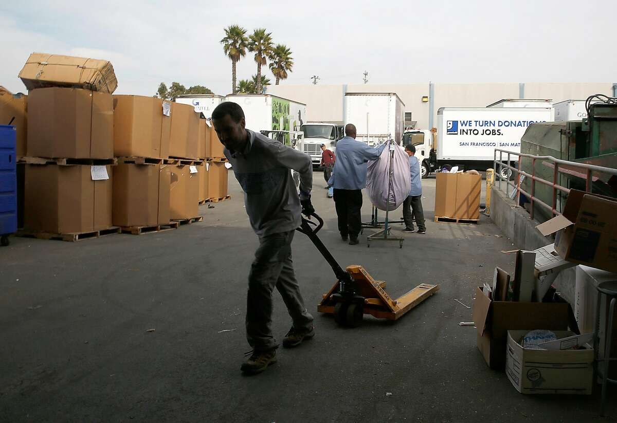 Workers at the Goodwill warehouse on Tuesday, October 17, 2017, in South San Francisco, Calif.