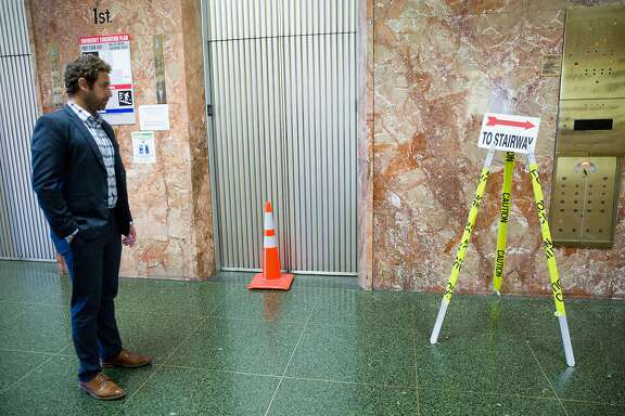 Max Szabo of the District Attorney's Office on the first floor next to the out of order elevator at the Hall of Justice on Thursday, Oct. 26, 2017, in San Francisco, Calif. The Board of Supervisors will vote Tuesday on whether to approve three property leases that would allow various city departments to move out of the old Hall of Justice, but three supervisors might hold up the process because they think the city should purchase new buildings rather than lease them.