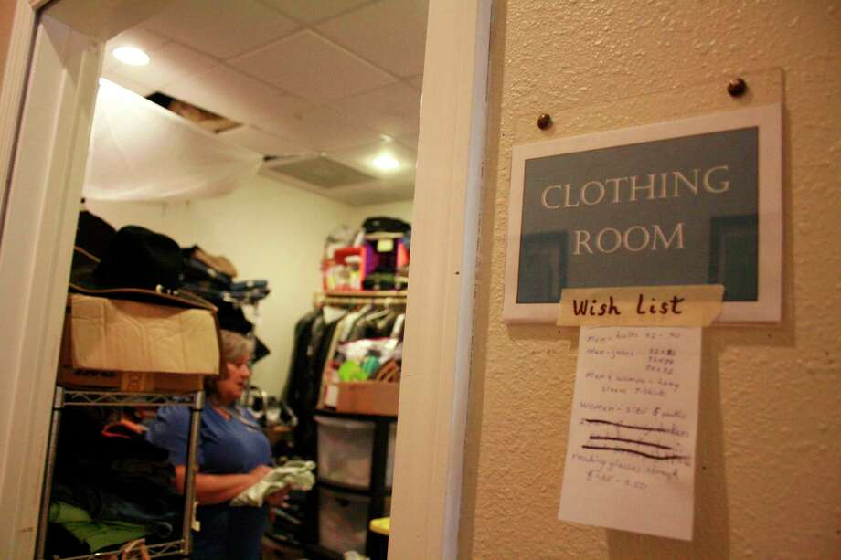 Teresa Killen, a volunteer at the 1960 Hope Center, is in charge of the clothes closet, where donated clothes areorganized and folded before being distributed to homeless people seeking a change of clothes. Photo: Mayra Cruz