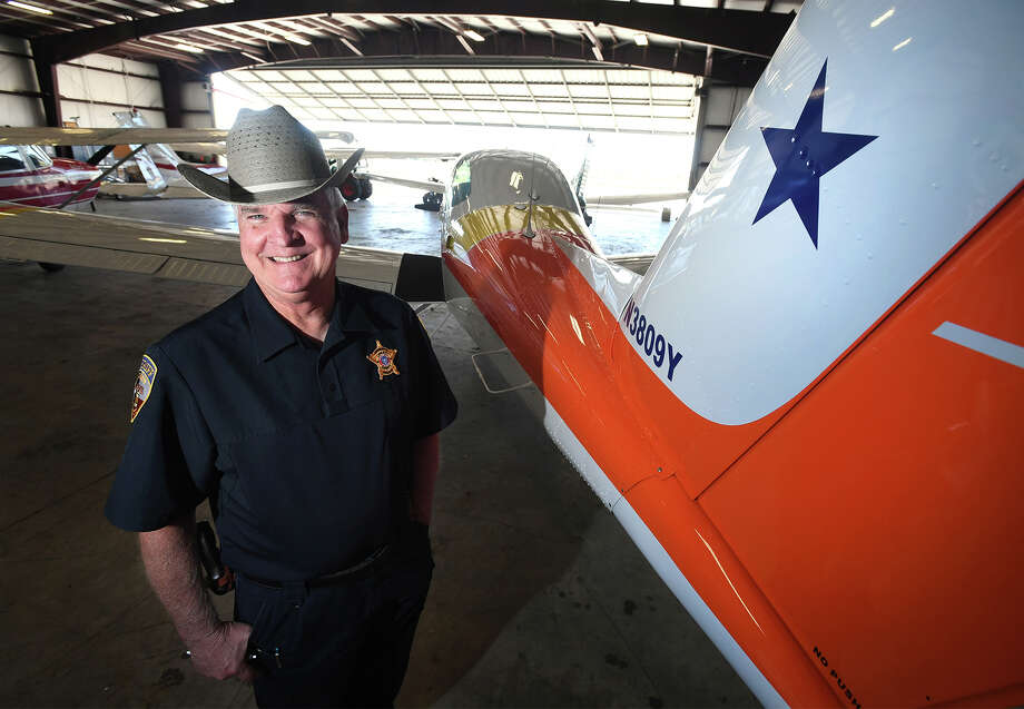 Astros fan, Kent Shaffer of the Beaumont area stands by his 1980 Beechcraft Skipper plane he had painted red and orange to match the rainbow colors of the Houston baseball team that is currently competing in the World Series. Photo taken Tuesday, October 24, 2017 Guiseppe Barranco/The Enterprise Photo: Guiseppe Barranco, Photo Editor / Guiseppe Barranco ©