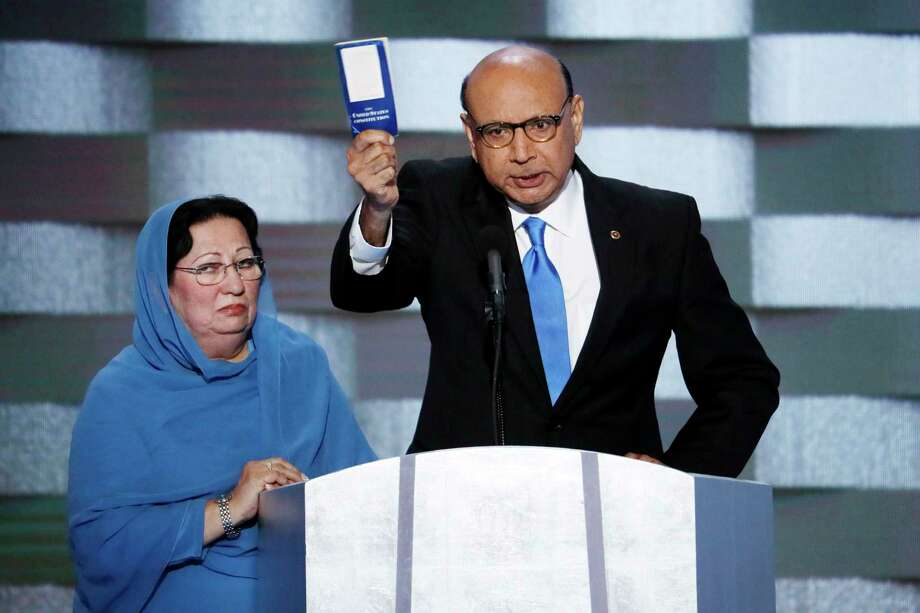 Khizr Khan holds a copy of Constitution of the United States, which he offered to lend to Donald Trump, with his wife Ghazala Khan, at the Democratic National Convention in 2016. Photo: Michael Bryant/Philadelphia Inquirer/TNS, STF / AP