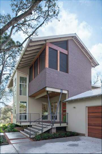 How new, smart design saved the day for some Houston ... Raised S House Designs on flood proof house designs, small house designs, coastal home designs, dead house designs, flat house designs, elevated house designs, large house designs, living house designs, light house designs, coastal stilt house plans designs, inspired house designs, glass house designs, raised glass, ranch house designs, raised houses in new orleans, standard house designs, blue house designs, square house designs, home floor plans and designs, award-winning beach house designs,