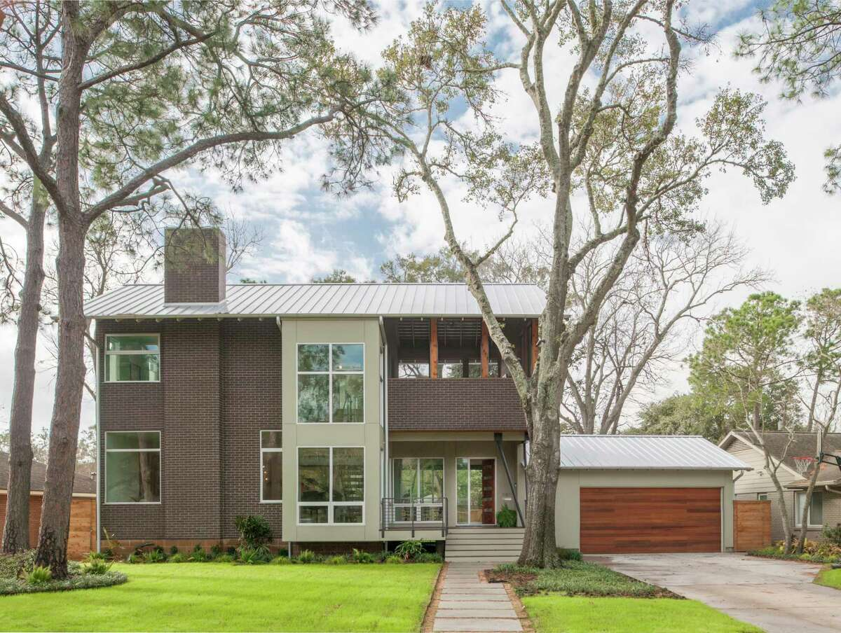 The owners of this new-construction home on Linkwood Drive elevated it roughly 4 feet above ground level because the neighborhood is located in a flood-prone area.