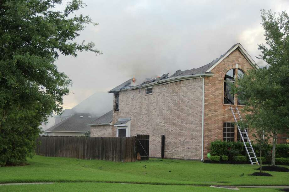 A house in the Lakes of Savannah subdivision southwest of Pearland was completely destroyed by fire after lighting struck the roof on April 24. / Kristi Nix