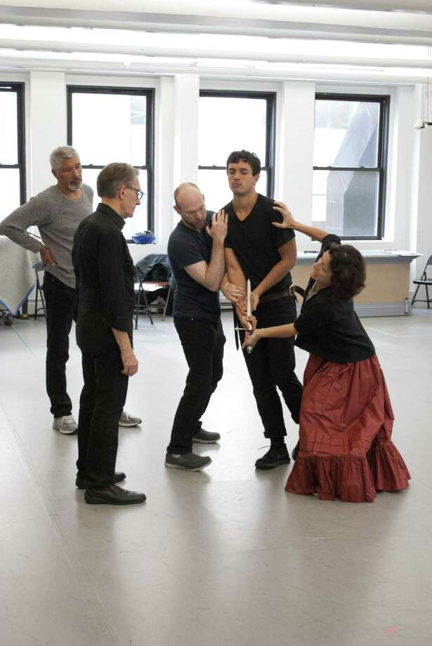 """Peter Francis James, left, director Mark Lamos, Jim Ludlum, James Cusati-Moyer (Romeo) and Felicity Jones Latta in a rehearsal death scene for Shakespeare's """"Romeo and Juliet"""" at the Westport Country Playhouse. Photo: Westport Playhouse / Contributed Photo"""
