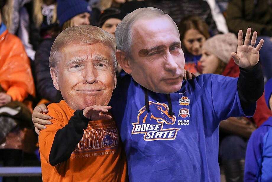 Fans wearing Donald Trump and Vladimir Putin masks during the Wyoming-Boise State football game in Idaho last weekend. Photo: Loren Orr, Getty Images