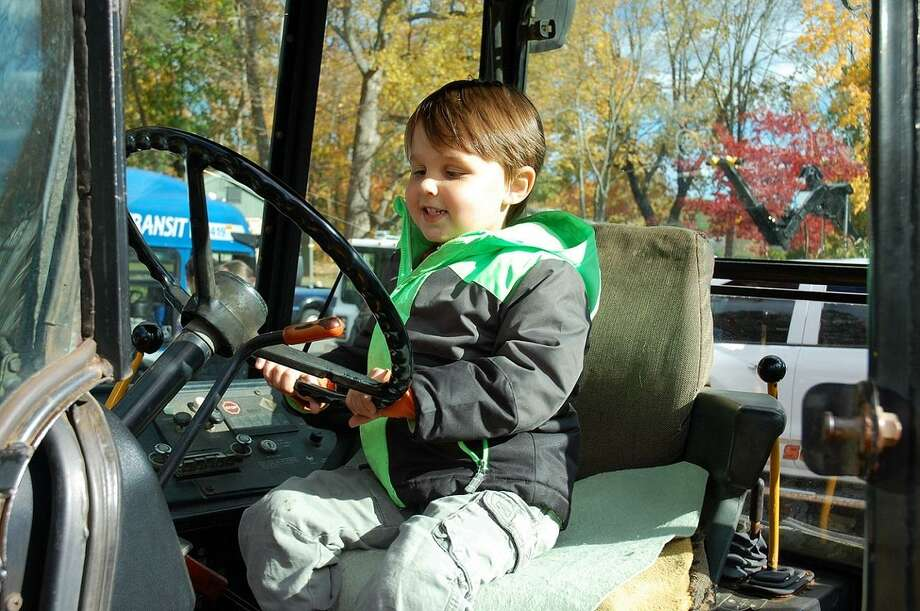 """Jumping aboard """"big trucks"""" is one of the features of a special family day on Sunday, Nov. 5, at the Stamford Museum & Nature Center. Photo: Stamford Museum / Contributed Photo"""