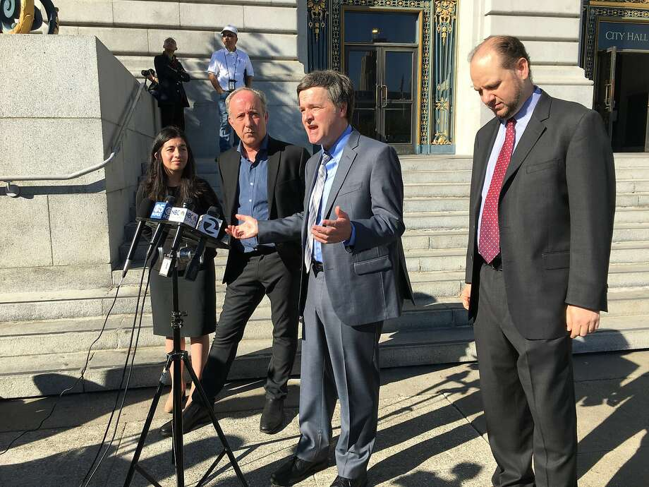 Left to right: Marta Mendoza, Dale Duncan and the couple's attorneys, Steven McDonald and Ariel Gershon, who announced Friday, Oct. 27, 2017, a $3.5 million jury verdict against the Duncans' former landlord. Photo: Dominic Fracassa