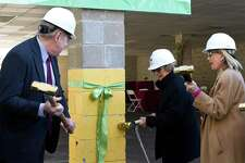 Stamford Mayor David Martin (left) and Adele Gordon (center), who works in strategic planning for Community Health Center, Inc., weild sledgehammers during a ground breaking ceremony on Friday October 27,2017 at 22 Fifth St. in Stamford, Connecticut. Once rennovations are complete, the Fifth Street building will serve as a new state-of-the-art homebase for Stamford's Community Health Center, Inc.