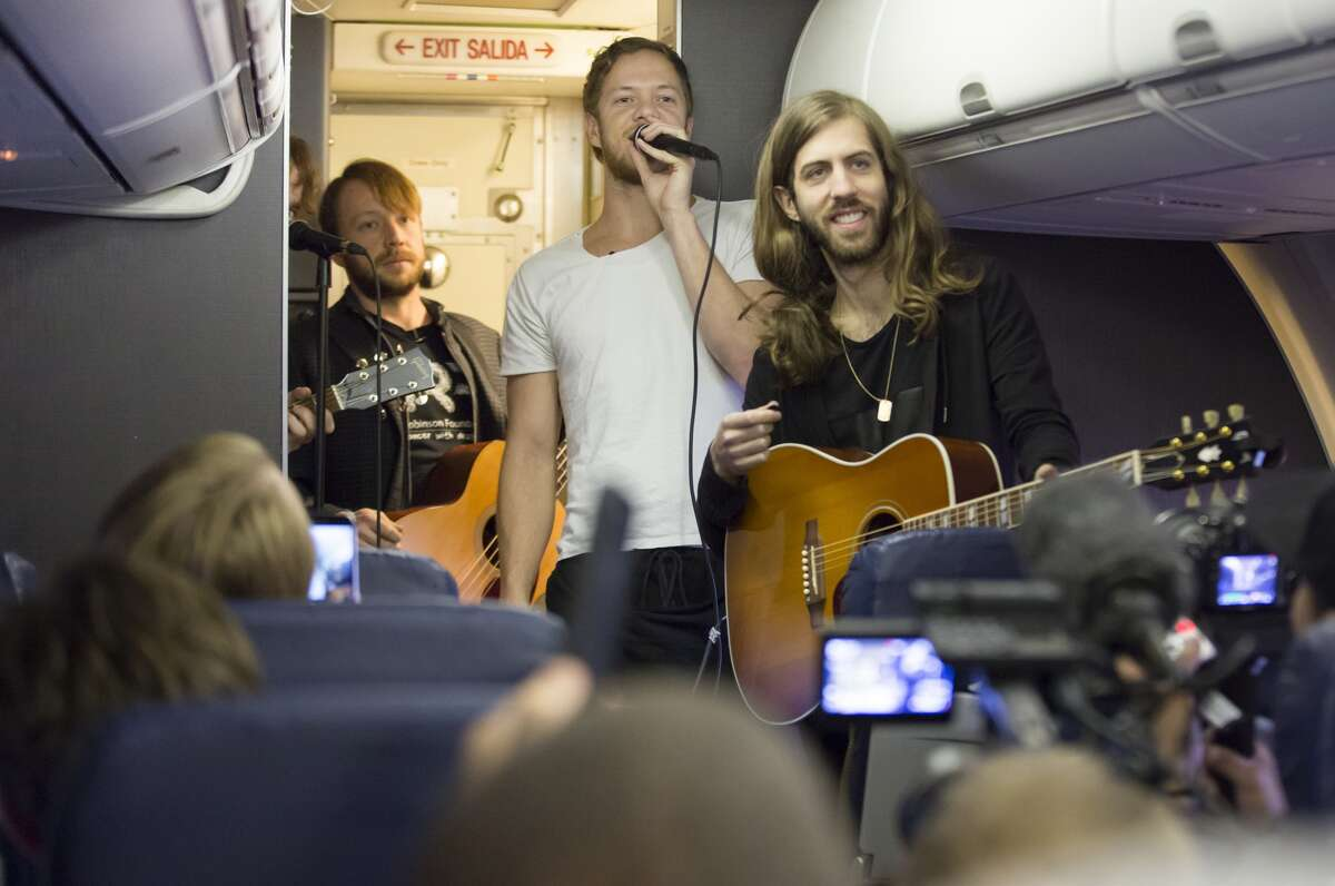 (L-R) Dan Platzman, Ben McKee, Dan Reynolds, Daniel Wayne Sermon of Imagine Dragons perform on a flight from Las Vegas to Atlanta for 'Live at 35' as part of their Destination Dragons tour presented by Southwest Airlines February 24, 2015 in Las Vegas, Nevada.