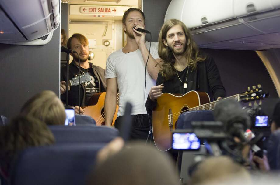 (L-R) Dan Platzman, Ben McKee, Dan Reynolds, Daniel Wayne Sermon of Imagine Dragons perform on a flight from Las Vegas to Atlanta for 'Live at 35' as part of their Destination Dragons tour presented by Southwest Airlines February 24, 2015 in Las Vegas, Nevada. Photo: (Photo By Garrett Menichini/Southwest Airlines Via Getty Images)