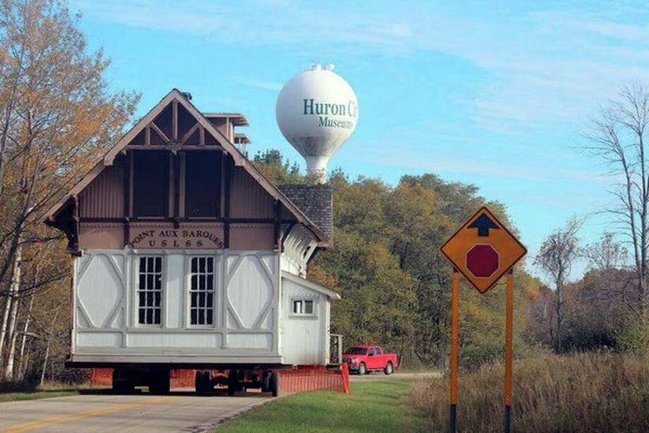 Movers are preparing to relocate the Pointe aux Barques Life Saving Station Wednesday from the Huron City Museum Complex close to its original location in Lighthouse Park. (Submitted Photo)