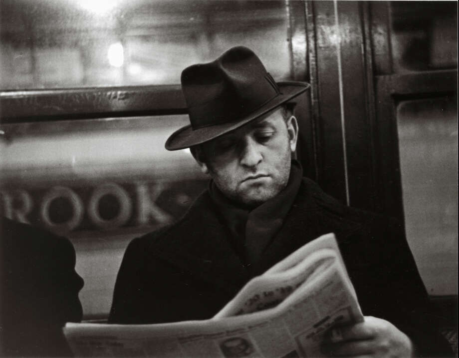 """In this photo provided by the San Francisco Museum of Modern Art is the photograph by Walker Evans called """"Subway Portrait"""" taken between 1938-1941. The photo is part of a new retrospective exhibit at the San Francisco Museum of Modern Art featuring 400 pieces of Walker's vintage prints, paintings and items from his personal collection. The exhibit was conceived as a 50-year retrospective highlighting the photographer's fascination with popular culture or vernacular — a celebration of the beauty in everyday life. (Walker Evans/San Francisco Museum of Modern Art via AP) Photo: Walker Evans, HONS / San Francisco Museum of Modern Art"""