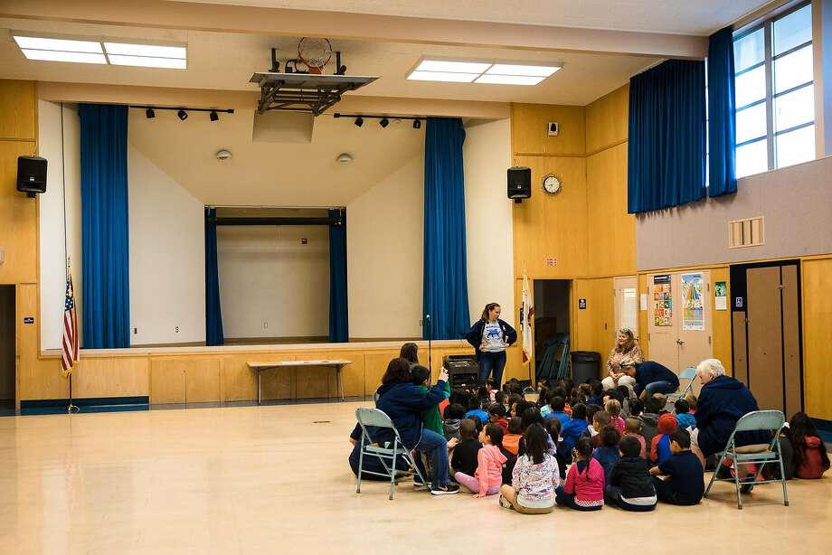 Principal Michelle Smith meets with kindergarten students and teachers in the gymnasium to talk at James Monroe Elementary in Santa Rosa, Calif. Friday, October 27, 2017. Photo: Mason Trinca, Special To The Chronicle
