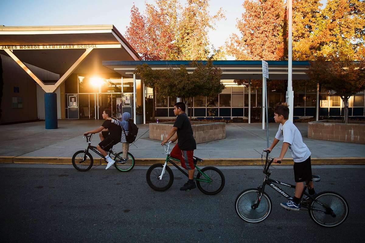 Students ride their bikes to school at James Monroe Elementary in Santa Rosa, Calif. Friday, October 27, 2017.