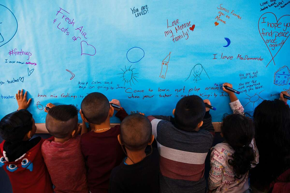 Cynthia Cousland's kindergarten students sign the Wall of Positivity at James Monroe Elementary in Santa Rosa, Calif. Friday, October 27, 2017.