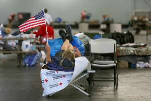 Larry Campbell, a homeless disabled man who had raised his family in Santa Rosa had lost his van used as home with all of his personal belongings in Fountaingrove during the fires, as he waits for instructions to move at the Sonoma County Red Cross shelter on Thursday, October 27, 2017, in Santa Rosa, Calif.  Two of the Red Cross fire shelters are still open including Sonoma County Fairgrounds where existing fire victims and homeless will move to the cafeteria .