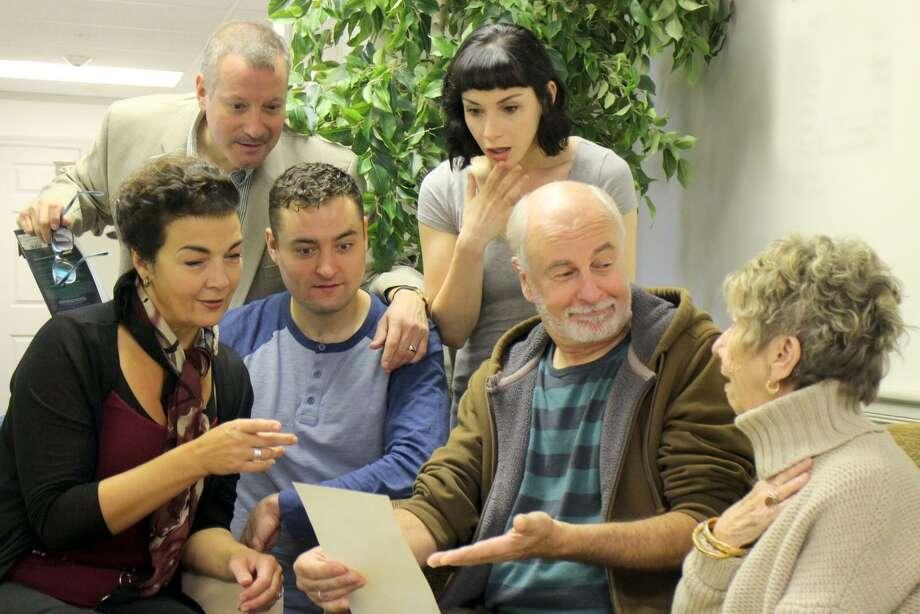 "From left: Katrina Ferguson, Michael Iannucci, Erik Bloomquist, Molly Densmore, Craig McDonald and Maggie McGlone Jennings star in ""The Play's Afoot."" Photo: Anne Hudson / Ivoryton Playhouse"