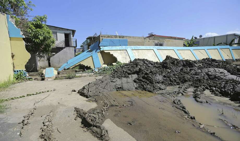 A view of a collapsed fence by the flood of the river at the Luis M. Santiago school, which remained closed Tuesday in Toa Baja, Puerto Rico. Photo: David Santiago / Associated Press / Miami Herald