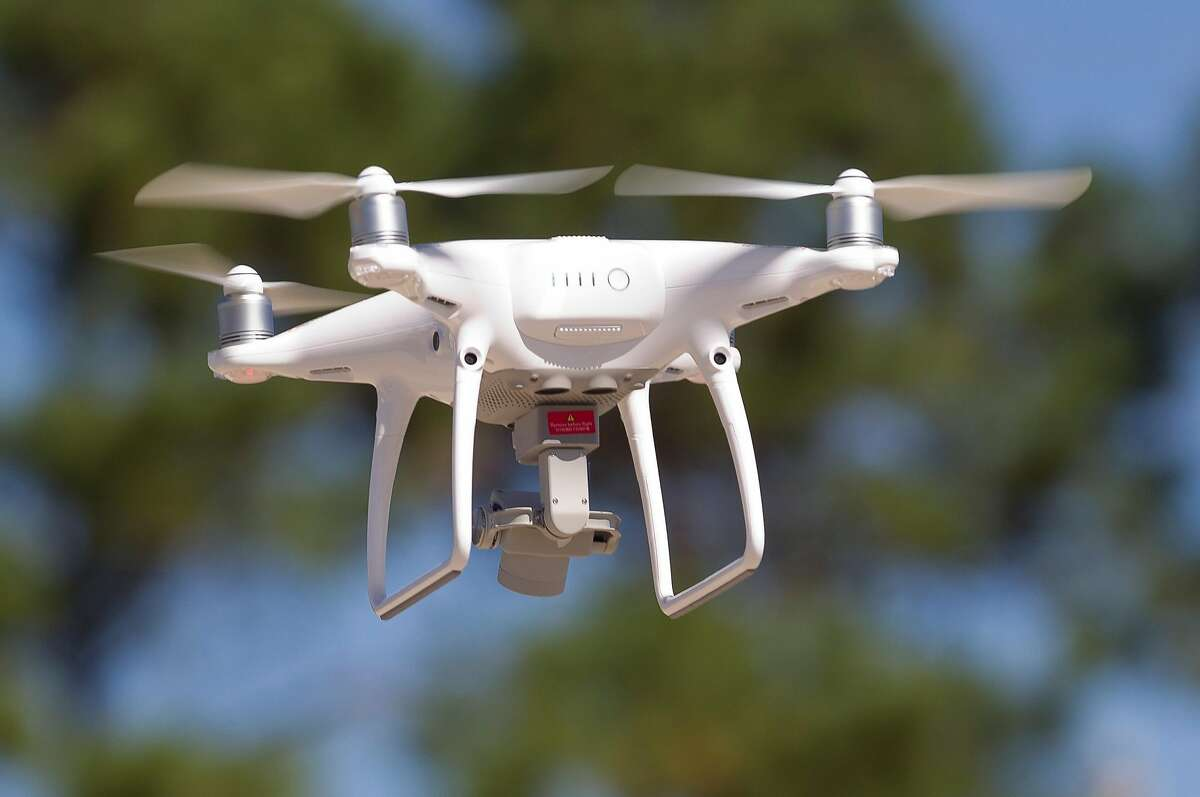 A DJI Phantom 4 quadcopter flies near Lake Conroe, Wednesday, Oct. 25, 2017, in Conroe. Drone System International donated the quadcopter and several remote pilot certification courses estimated at a combined $4,000 to the Montgomery County Precinct One Constable's Office Lake Patrol Division to aid in search and rescue efforts.
