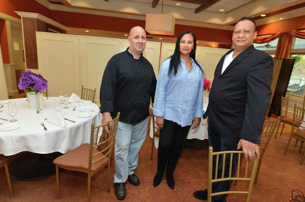Chef, Owner Vincent LaForte, Owner Stephanie Myers- LaForte and Owner Amar Haouari stand in the dining room at the Oak Hills Restaurant on the Green at Oak Hills Park on Thursday October 26, 2017 in Norwalk Conn