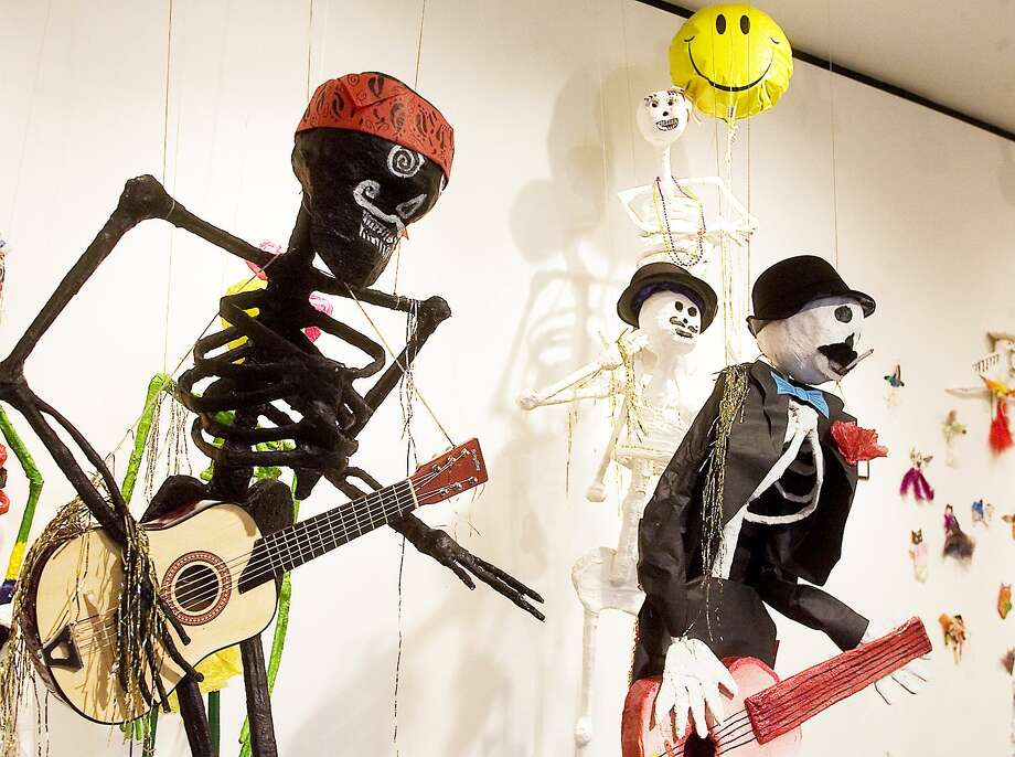 Waltrip High School designed a skeleton band for a Dia de los Muertos exhibit at the Lawndale Art Center in Houston. Photo: Patric Schneider / / Internal
