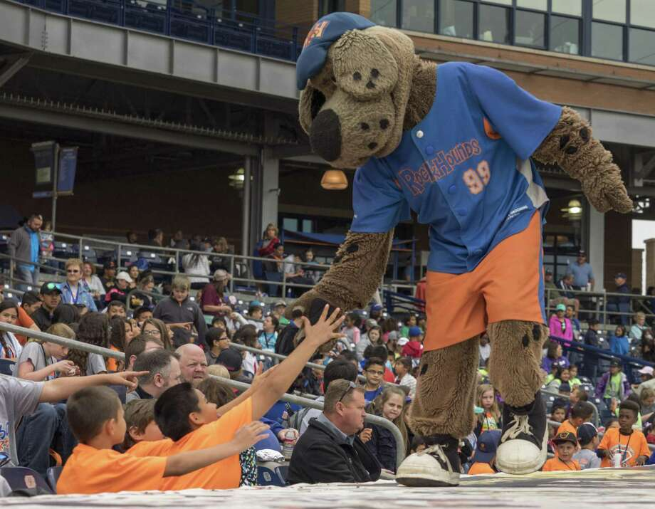 Rocky the Rockhound shakes hands with area school children during the RockHounds afternon game against the San Antonio Missions in May. Proposition 5 would allow minor league sports foundations to stage raffles for charity. Photo: Tim Fischer /Midland Reporter-Telegram