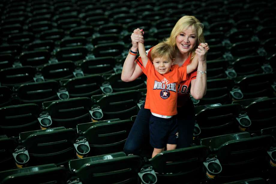 """Whitney Crane and her son, James Crane II, go all in on """"Mommy and me"""" Astros fashion at the Minute Maid Park. Photo: Marie D. De Jesus, Staff / © 2017 Houston Chronicle"""