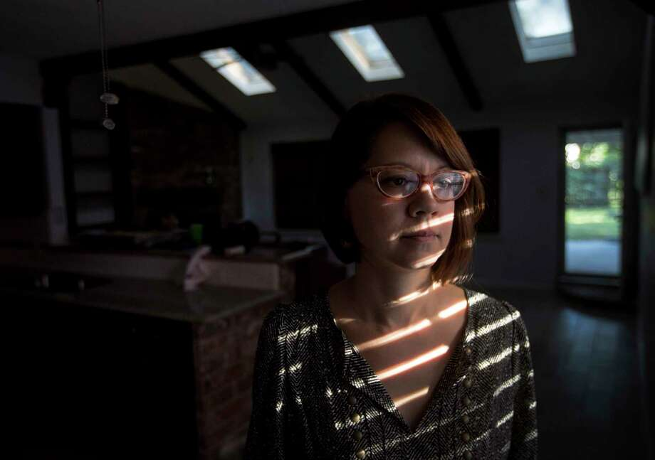 Amber Ambrose poses for a portrait in her house, which flooded during Hurricane Harvey, Thursday, Oct. 26, 2017, in Houston. Photo: Jon Shapley, Houston Chronicle / © 2017 Houston Chronicle