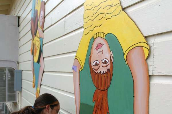 Whittier Middle School participated in a San Antonio Independent School District principal-for-a-day program on Monday. Here, Maria Ochoa signs her mural in 2004 during a dedication ceremony for a set of murals painted on the portable classrooms at the school.