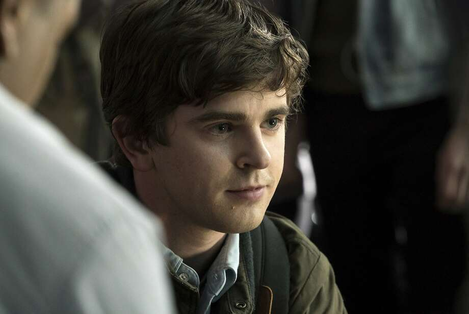 """In this image released by ABC, Freddie Highmore portrays Shaun Murphy in a scene from """"The Good Doctor."""" Highmore stars as a young surgeon with autism who joins a prestigious hospital's surgical unit. The show is a hit among older viewers. (Liane Hentscher/ABC via AP) Photo: Liane Hentscher, Associated Press"""
