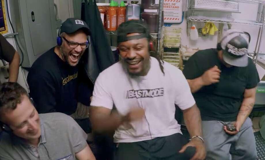 Marshawn Lynch pranks Ike's customers. Photo: PG Sports/YouTube