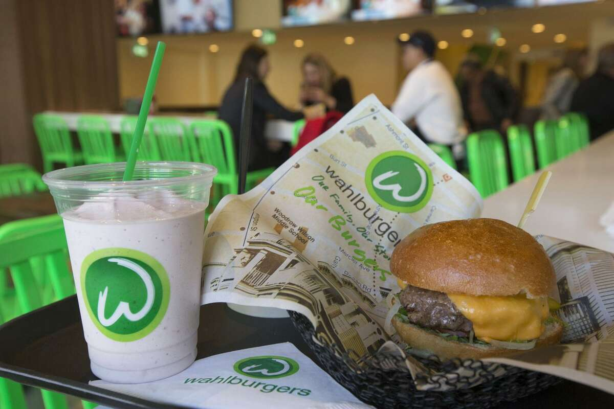 """The """"Our Burger"""" and the """"Funkey Monkey"""" adult Frappe at a Wahlburgers restaurant in Toronto. Connecticut's first Wahlburgers will have a soft opening at Westfield Mall in Trumbull this weekend."""