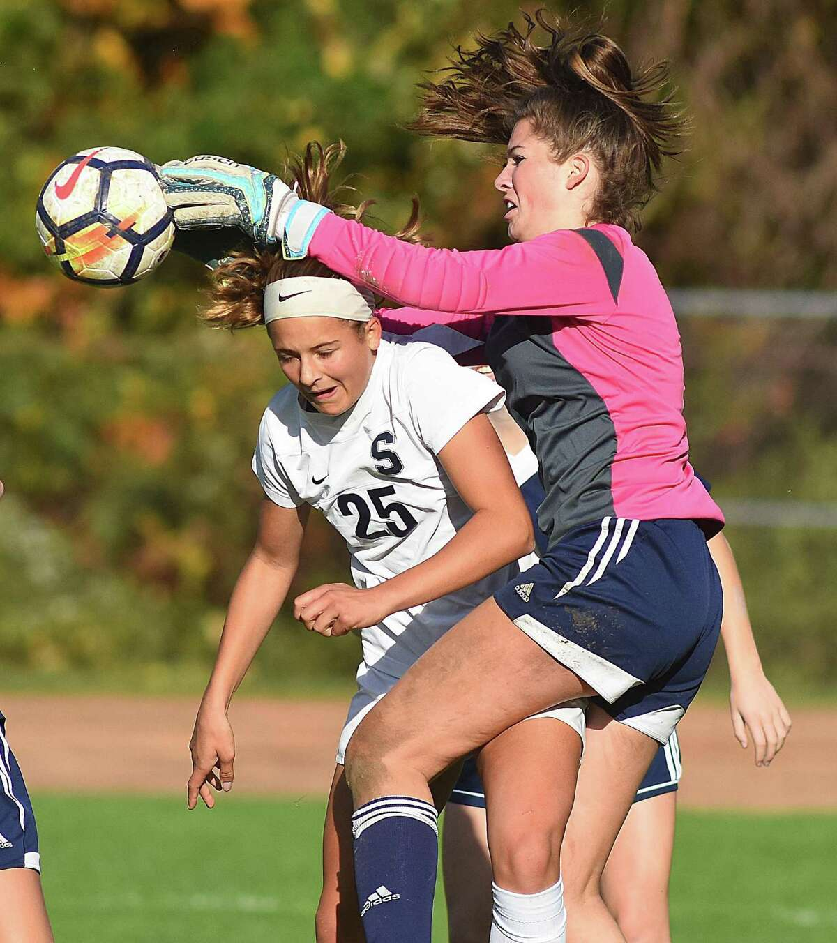 Wilton goalkeeper Taylor Floyd, right, goes up over the back of Staples' Marlo Von der Ahe during Friday's FCIAC girls soccer quarterfinal at Albie Loeffler Field in Westport. Staples won 2-0.