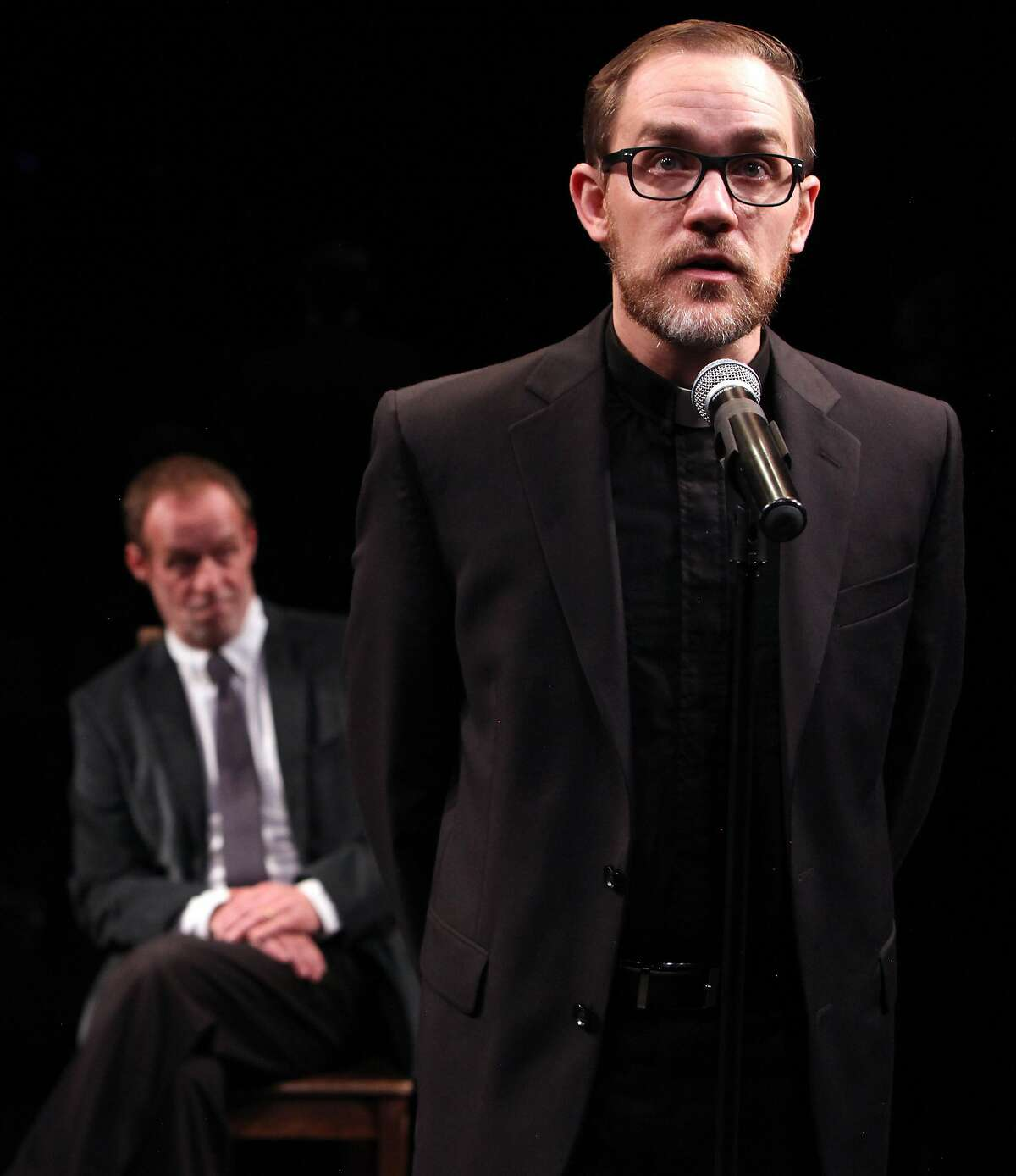 """From left: Rod Gnapp as�Eamon�and�Justin Gillman as�Father O'Leary�in Magic Theatre's """"The Eva Trilogy."""""""